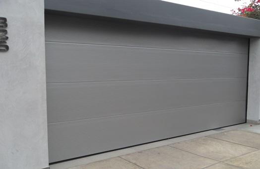 Puertas seccionales garaje gris aluminios y pvc gerardo for Puerta garaje metalica